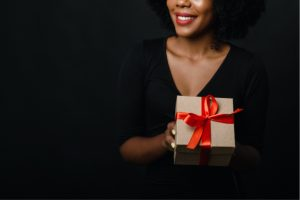 Black woman holding a wrapped present